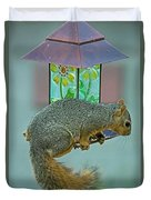 Squirrel At The Bird Feeder Duvet Cover