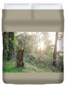 Sun Shining Through Trees In A Mysterious Forest Duvet Cover