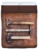 Three Hammers Against A Rust Background Duvet Cover