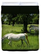Three White Lipizzan Horses Grazing In A Field At The Lipica Stu Duvet Cover