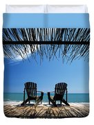 Two Chairs On Deck By Ocean Shaded By Duvet Cover
