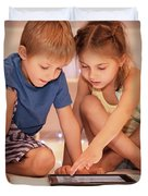 Two Happy Children Playing On The Tablet Duvet Cover