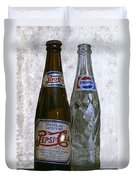 Two Pepsi Bottles On A Table Duvet Cover by Daniel Hagerman