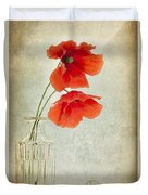 Two Poppies In A Glass Vase Duvet Cover
