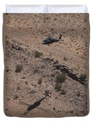 Uh-60 Black Hawk Hovers Above U.s Duvet Cover