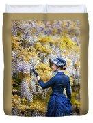Victorian Woman Admiring Wisteria Flowers Duvet Cover