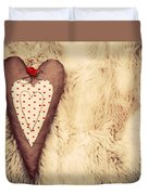 Vintage Handmade Plush Heart Pillow On The Soft Blanket Duvet Cover