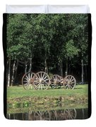 Wagon Wheels Reflecting In A Pond Duvet Cover