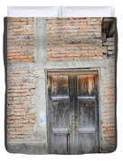 Weathered Wood Door In An Adobe Brick Wall Duvet Cover