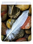 White Feather On River Stones Duvet Cover
