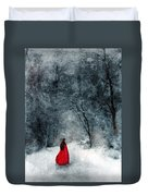 Woman In Red Cape Walking In Snowy Woods Duvet Cover