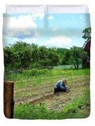 Woman Planting Garden Near Barn Duvet Cover