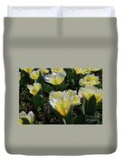 Yellow And White Tulips Flowering In A Garden Duvet Cover
