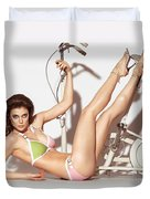 Young Woman In A Swimsuit Posing With Exercise Bike Duvet Cover