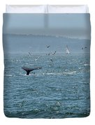 A Whale's Tail Above Water With Sail Boat In The Background Duvet Cover