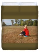 A Woman Is  Sitting In A Park And Admiring The Landscape Duvet Cover