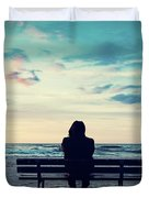 Man In Hood Sitting On A Lonely Bench On The Beach Duvet Cover