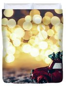 Red Car With Christmas Tree Driving Through Snow Duvet Cover