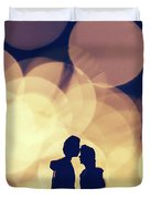 Romantic Couple Kissing On Illuminated Background. Duvet Cover