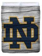 University Of Notre Dame Fighting Irish Logo On Rustic Wood Duvet Cover