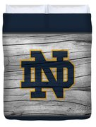 University Of Notre Dame Fighting Irish Logo On Rustic Wood Duvet Cover