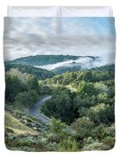 View Of Curved Road Through Dense Forest Area With Low Clouds Ov Duvet Cover
