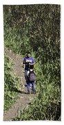 2 Photographers Walking Through Tall Grass Bath Towel