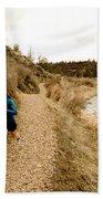 A Woman Jogging On A Dirt Trail Bath Towel