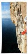 Climber Grabs A Hold While Climbing Bath Towel