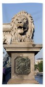 Lion Sculpture On Chain Bridge In Budapest Bath Towel