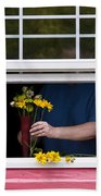 Mature Woman Cutting Flowers In Window Bath Towel