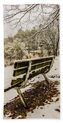 Park Bench In The Snow Covered Park Overlooking Lake Bath Towel