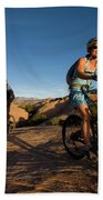 Couple Mountain Biking, Moab, Utah Bath Towel