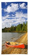 Red Canoe On Lake Shore Hand Towel
