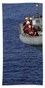 Sailors Lower A Rigid-hull Inflatable Bath Towel