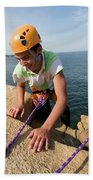 Rock Climbing On Oceanside Cliffs Bath Towel