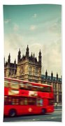 London Uk Red Bus In Motion And Big Ben Hand Towel
