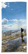 A Backpacker Stands Atop A Mountain Bath Towel