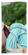 A Climber Holds Ropes Over Shoulder Bath Towel