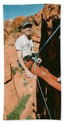 A Climber On Panty Wall In Red Rock Bath Towel