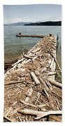 A Dock Covered With Driftwood Bath Towel