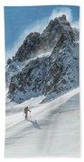 A Man Ski Touring In The Mountains Bath Towel