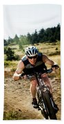 A Man Speeds Down A Trail On A Mountain Hand Towel