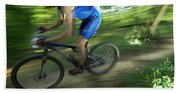 A Mountain Biker Races On A Trail Bath Towel