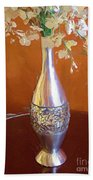 A Painting Silver Vase On Table Bath Towel