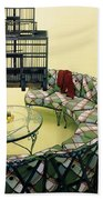 A Round Couch And A Birdcage Hand Towel