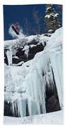 A Snowboarder Jumps Off An Ice Hand Towel