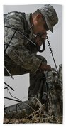 A Soldier Communicates Using A Bath Towel