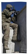 A U.s. Soldier Provides Security At An Bath Towel