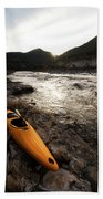 A Whitewater Kayak Rests On The Shore Hand Towel